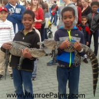 2 boys with 2 gators.jpeg